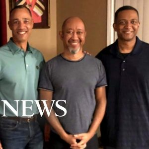 Army general adopted as baby reunites with half-brothers